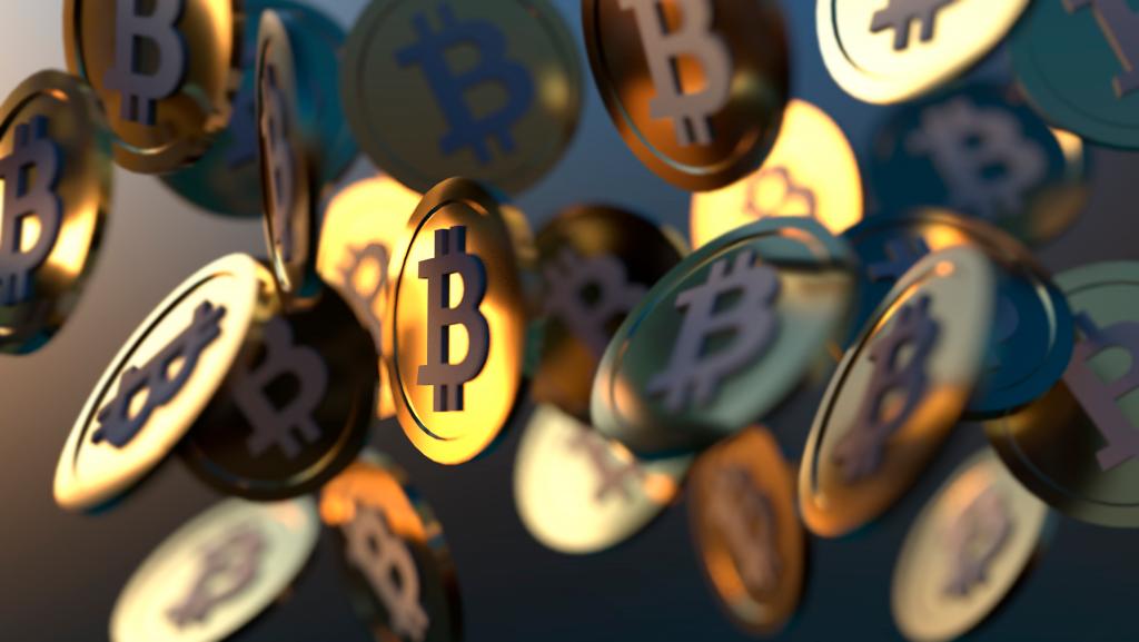 Monedas volando con el símbolo de Bitcoin